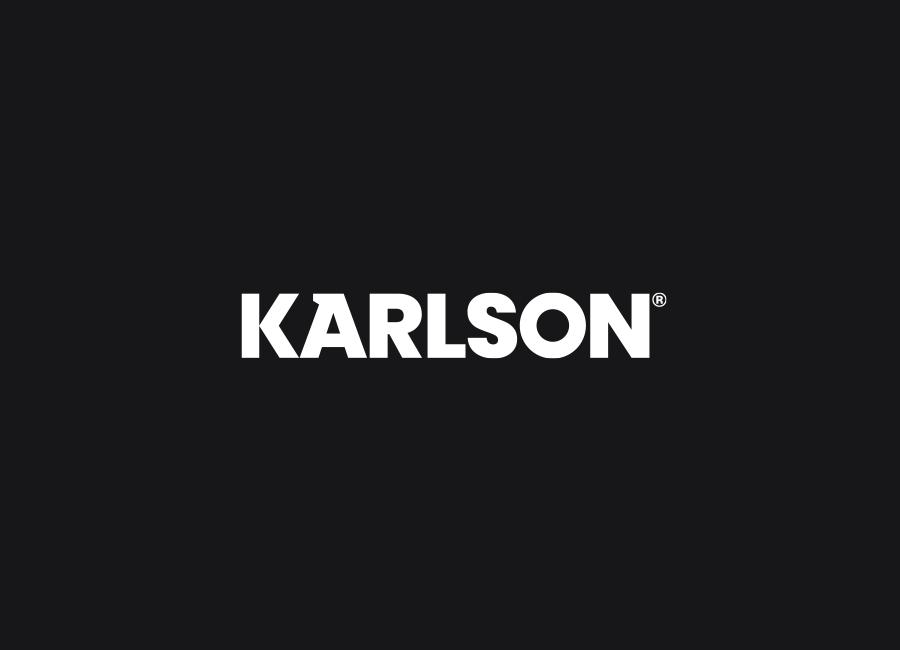 Karlson bespoke industrial wordmark on dark background