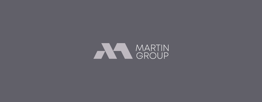 Martin Group realty corporate logo design on dark background