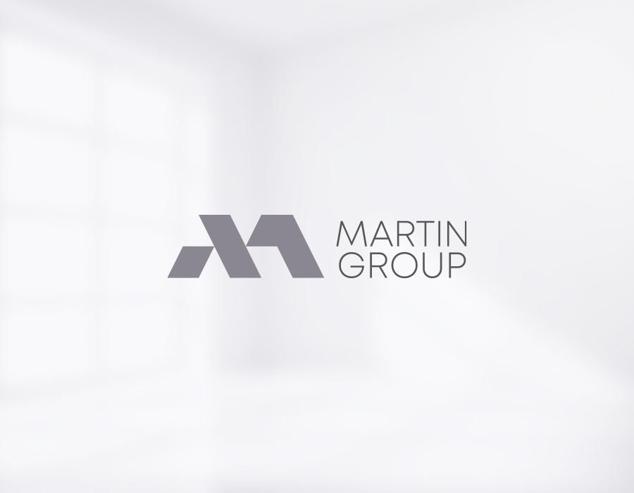 Martin Group realty corporate logo design on light background