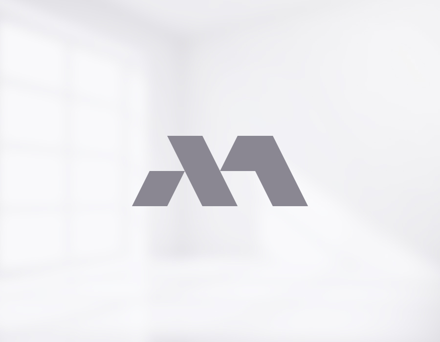 Martin Group realty corporate logo design mark on light blurred background
